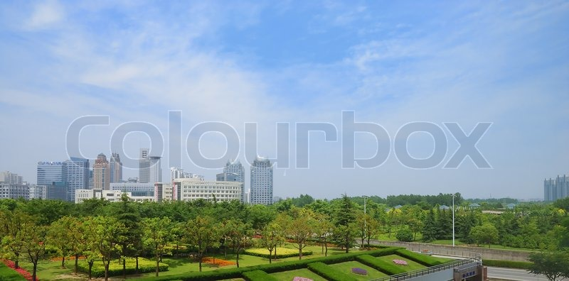 Beatiful garden and city scape on the background, stock photo