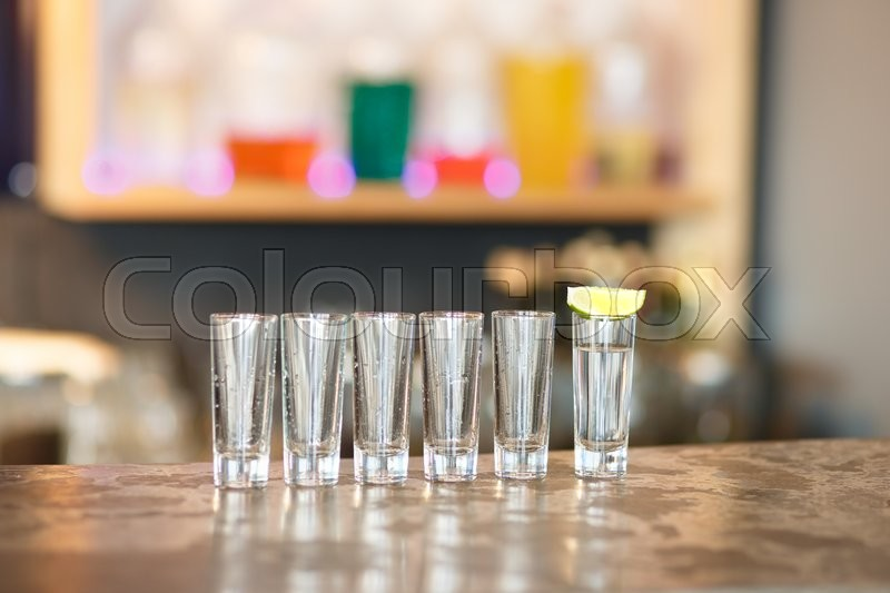 Empty and full glasses ready for use in the bar, stock photo