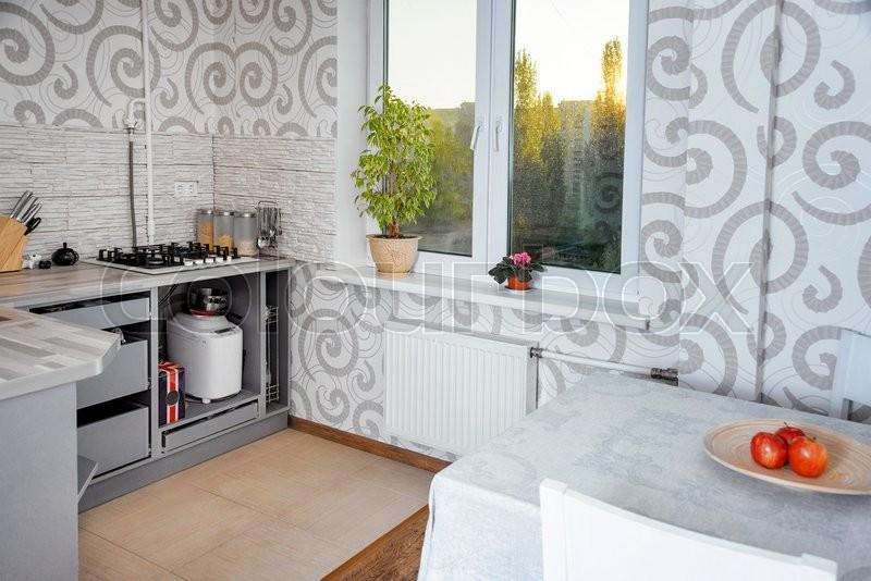 Modern simple kitchen interior design in light apartments, stock photo