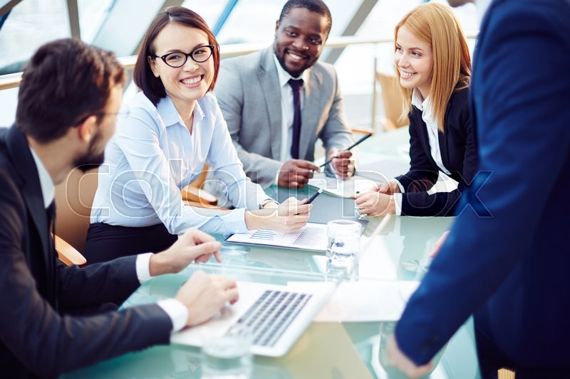 Business team discussing together business plans, stock photo