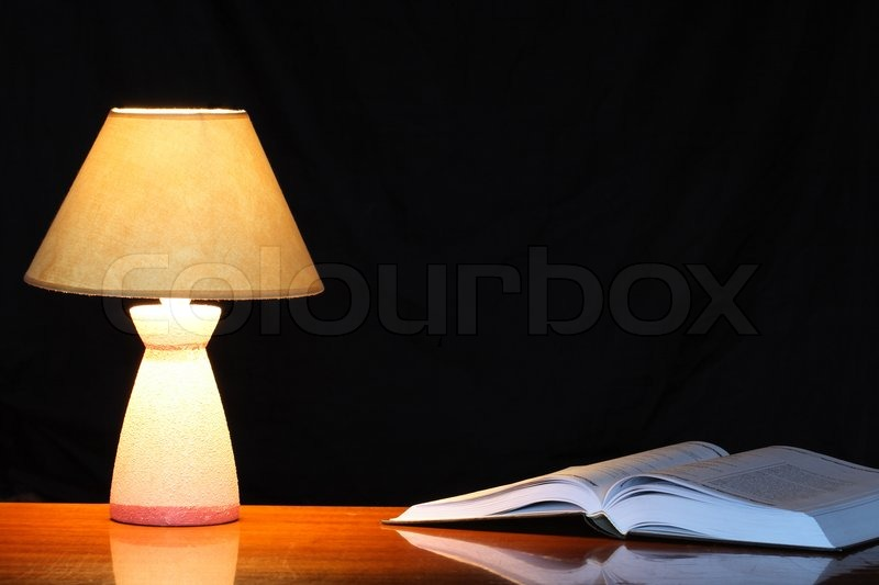 Vintage Table Lamp With Shade Near Open Book On Dark Background | Stock  Photo | Colourbox