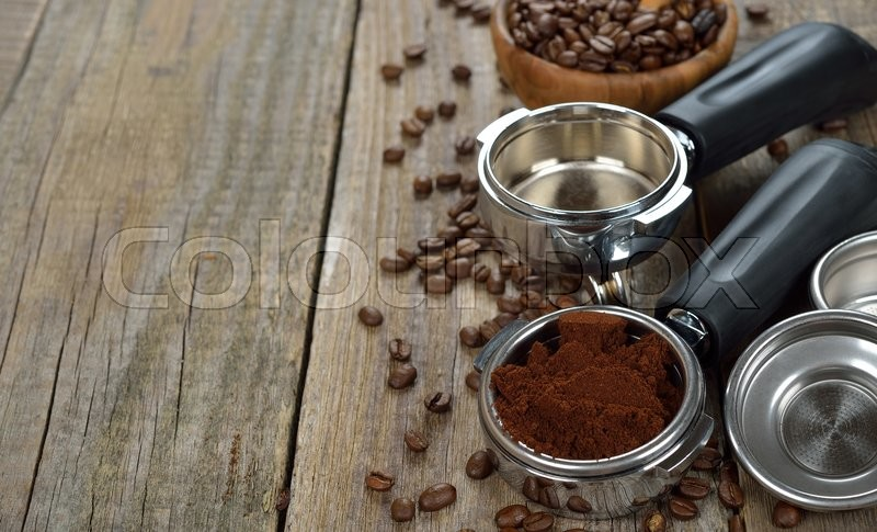 Holder with ground coffee on a wooden background, stock photo