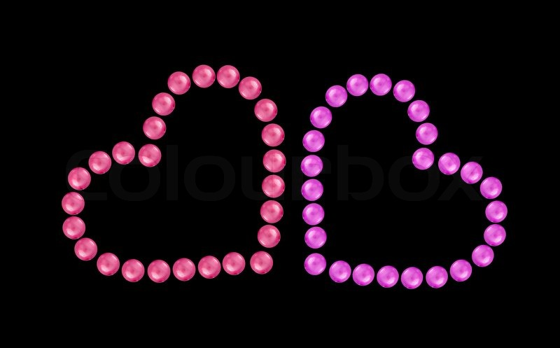 hearts from pink and red beads isolated on black background stock photo colourbox
