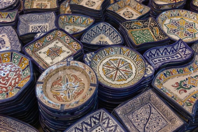Traditional Moroccan craftsmanship, brightly painted ...