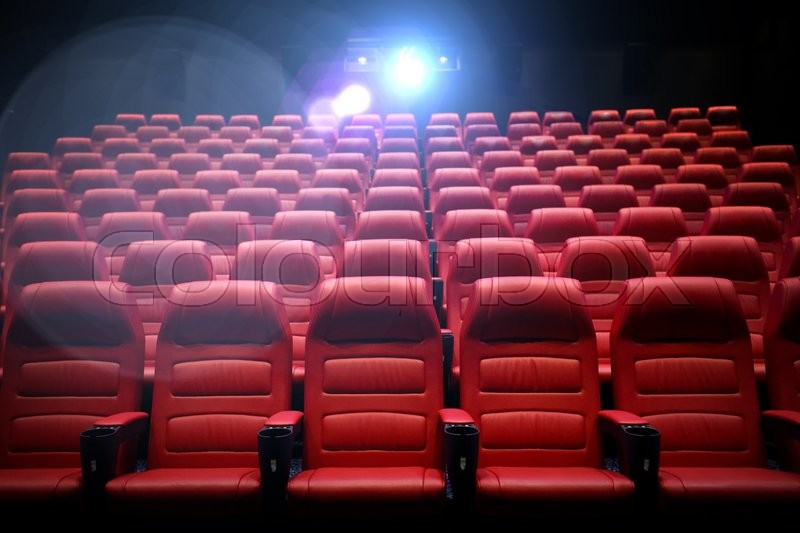 Entertainment and leisure concept - movie theater or cinema empty auditorium with red seats, stock photo