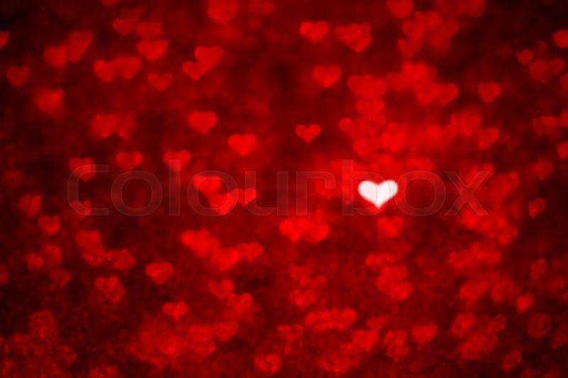 Bokeh Heart Shape Of Light Background Stock Footage Video: Heart Shape And Red Light Bokeh Background. Valentines Day