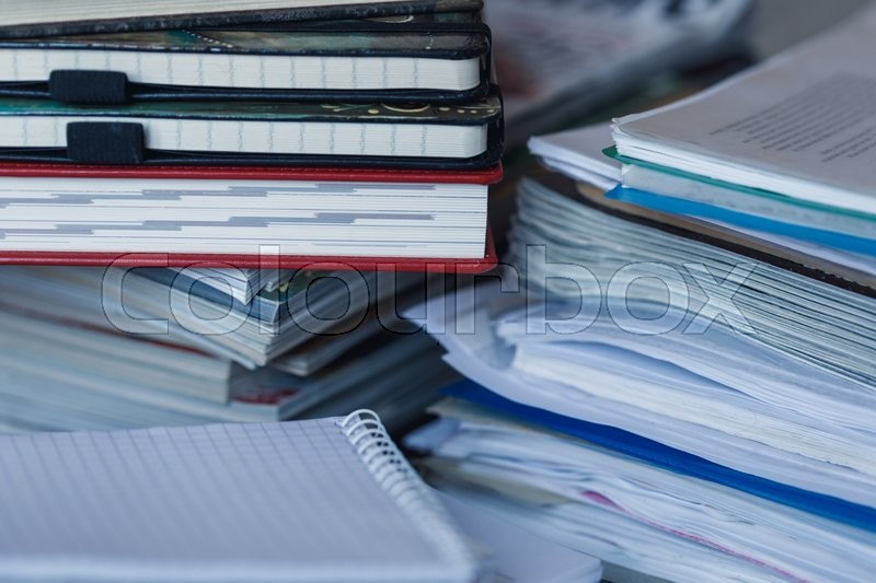 Accounting and taxes. Large pile of magazine, notebook and books closeup, stock photo