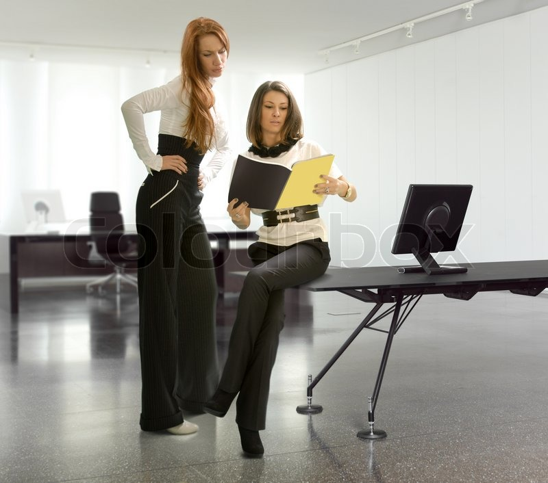 Two business women in the office have discussing matter of business
