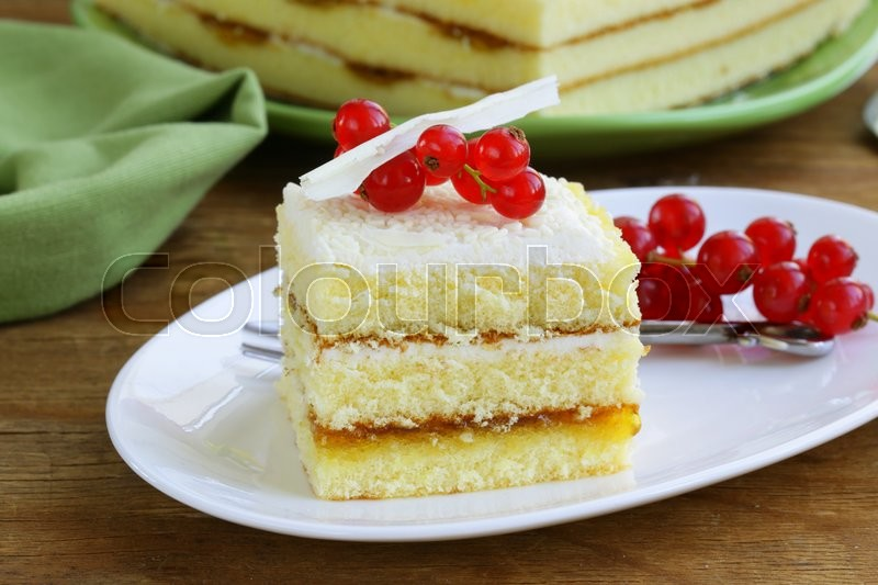 Sponge cake with white chocolate, decorated with red currant, stock photo