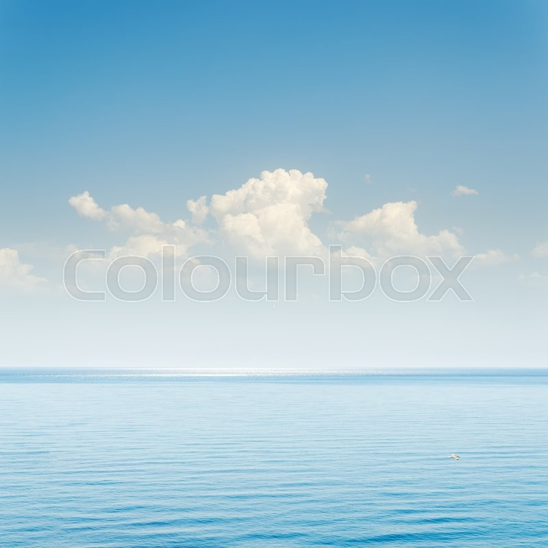 Blue sea and sky with clouds over it, stock photo