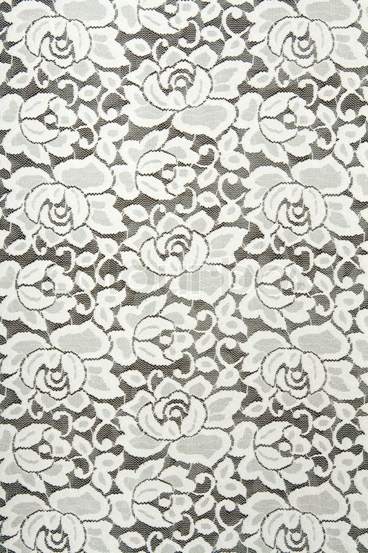 white lace with floral pattern on black background stock
