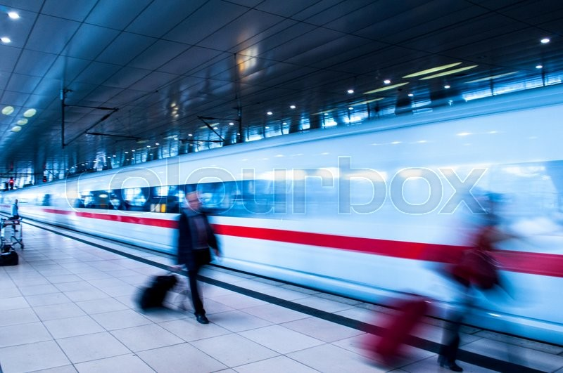 Frankfurt Airport Train station with blur business people movement in rush hour, stock photo