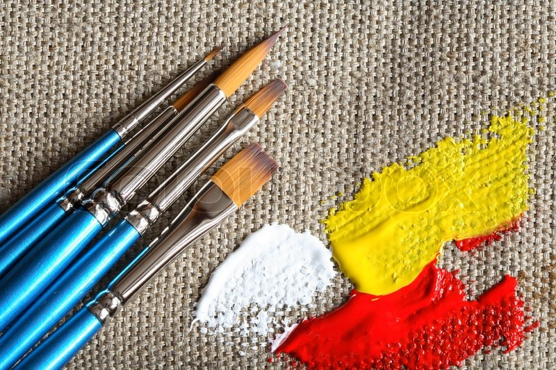 Set of paintbrushes and color paint on canvas background for How to do painting on canvas