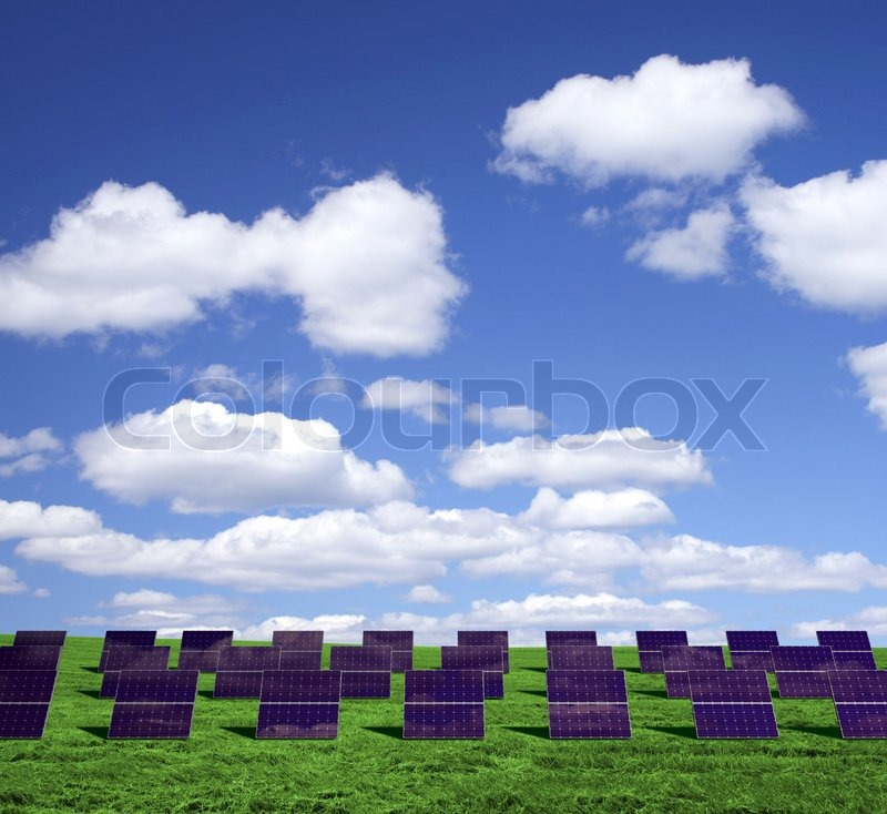 Solar energy panels on a green field | Stock Photo | Colourbox