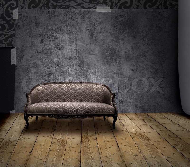 Antique Sofa In Rough Patina Wall And Old Wooden Floor Room Stock