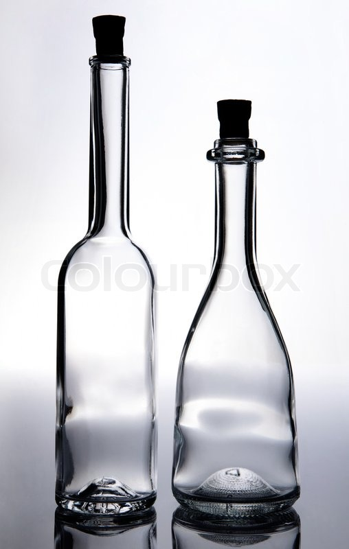 Old fashioned transparent empty wine bottles with cork, stock photo