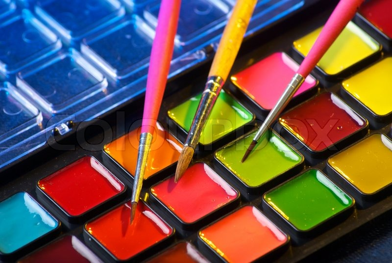 closeup of a palette of watercolor paints with three brushes stock photo colourbox