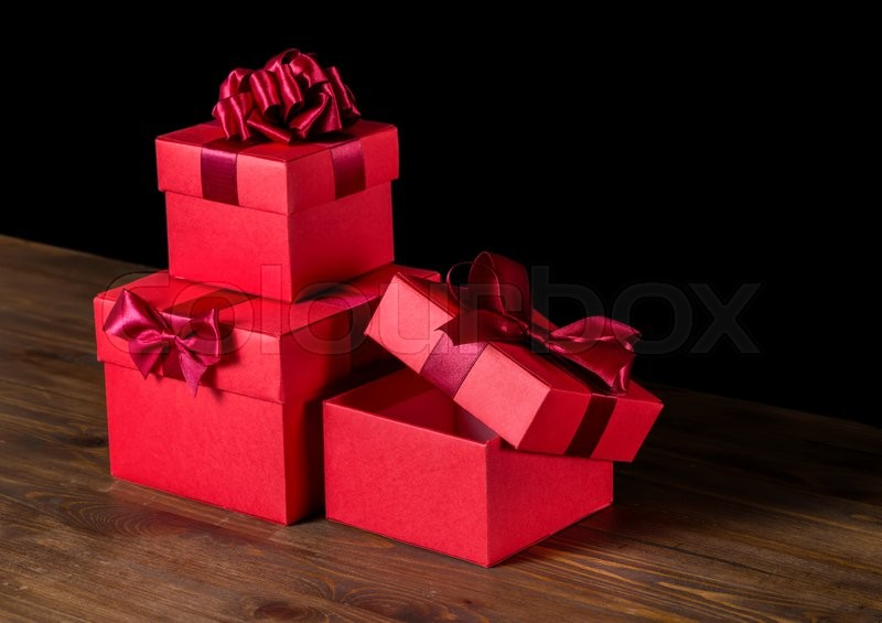 Festive opened boxes with bow on wooden background is isolated, stock photo