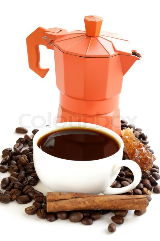 Stock image of 'still life of coffee beans, cup of espresso and coffee maker'