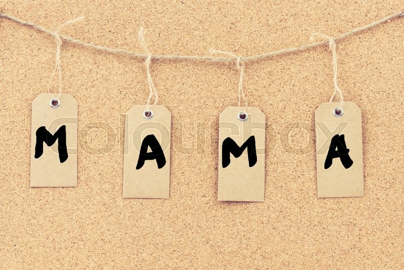 Stock image of 'Vintage grunge tags with letters on rope string, word MAMA over cork board texture background, filter applied, available copy space. '