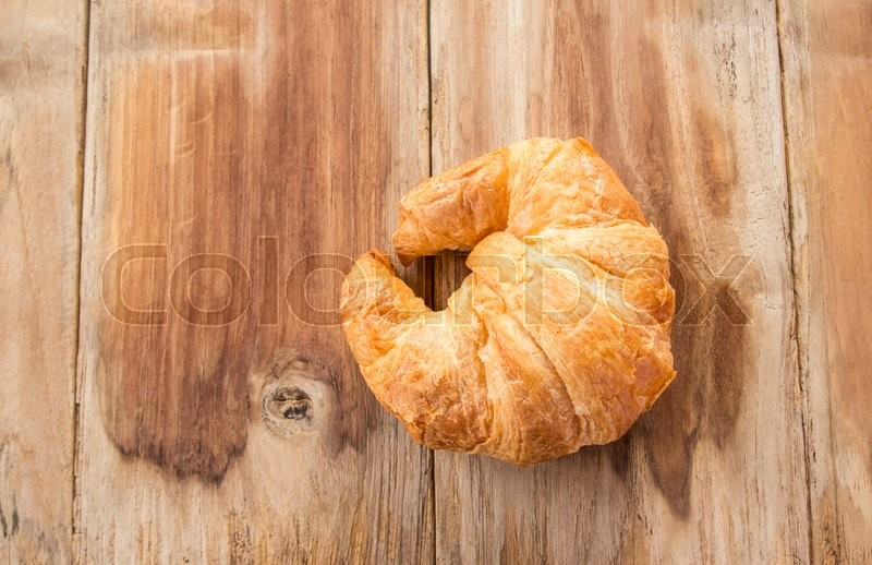 Stock image of 'Fresh croissants on old wooden table background'