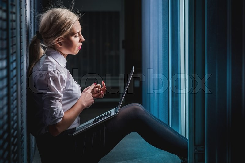 Stock image of 'Young engineer businesswoman in network server room. Russia.'