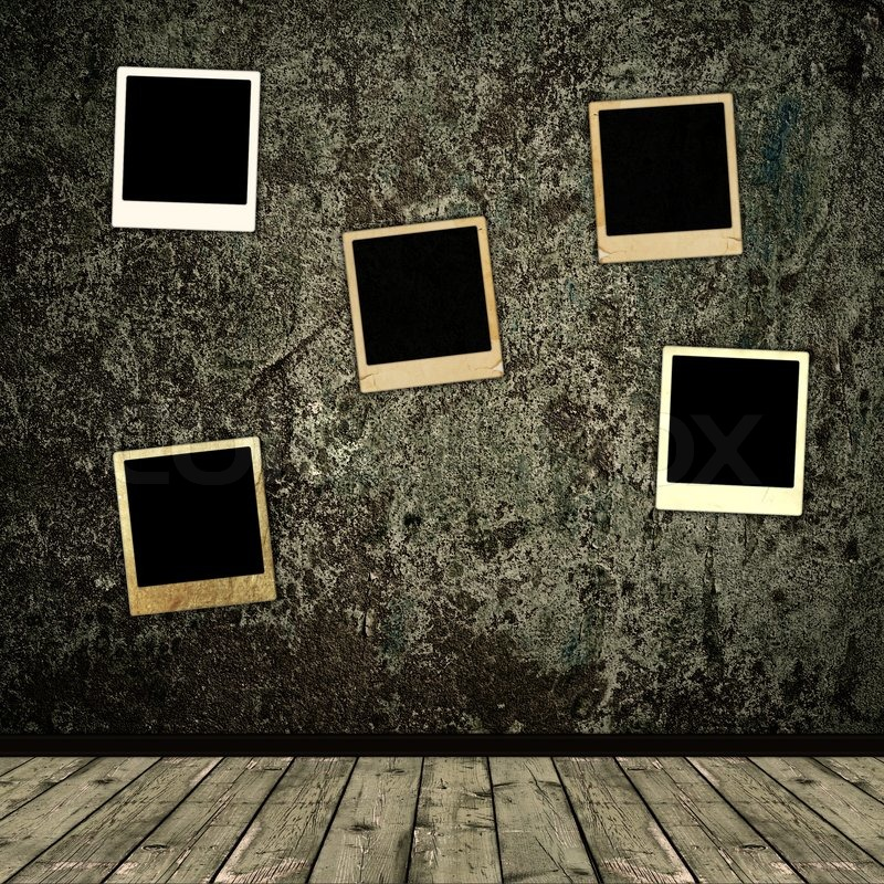 Old photo frames over the grunge wall     | Stock image