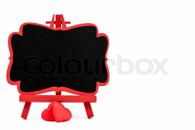 Stock image of 'Red frame wooden easel mini blackboard with chalkboard surface, empty space for text and two red heart shape symbols, isolated on white with clipping path, copy space available, Valentines day concept'
