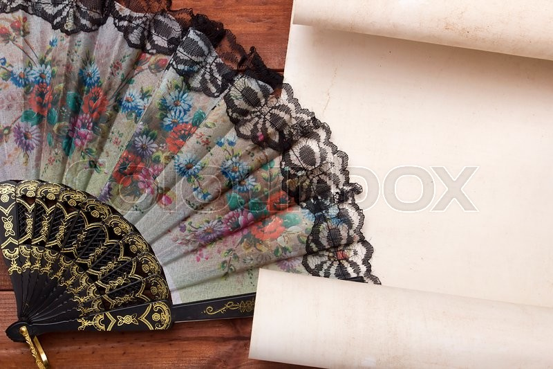 Stock image of 'Parchment for your text with a female fan with a floral pattern.'