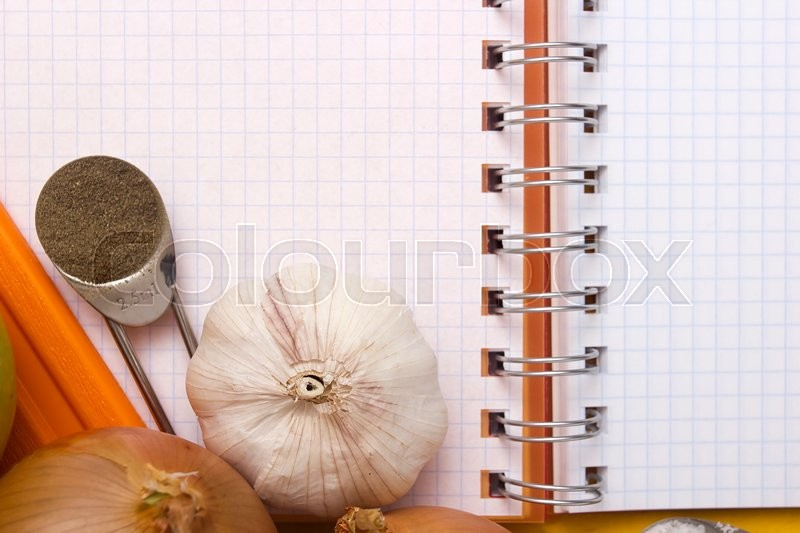 Stock image of 'Blank paper for recipes over wooden background with garlic.'