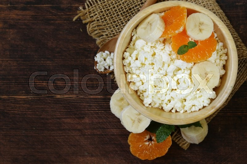 Stock image of 'Natural organic cottage cheese for healthy breakfast'