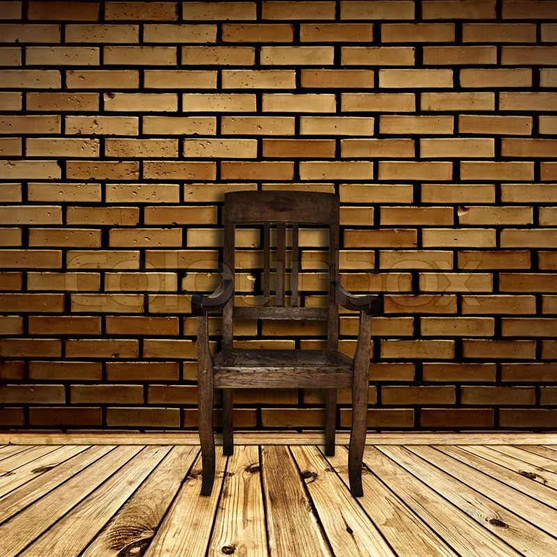 single chair at wooden floor against beige brick wall stock photo colourbox. Black Bedroom Furniture Sets. Home Design Ideas