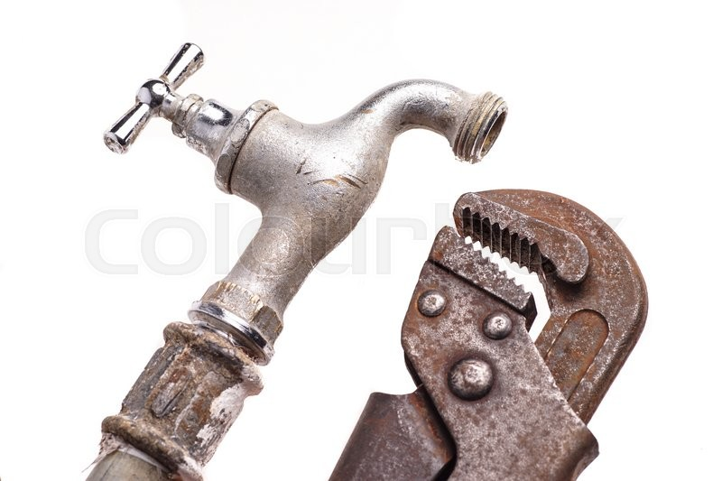 Stock image of 'plumbing tools lying with old pipes and faucets'