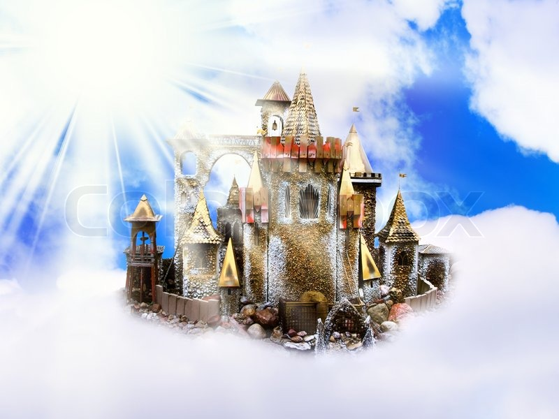 magic castle in the clouds over sun and blue sky