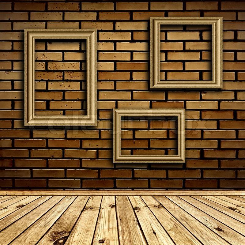 Three frames at beige brick wall under wooden floor | Stock Photo ...