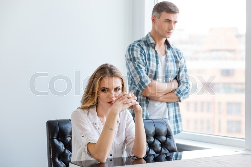 Stock image of 'Unhappy couple ignoring each other after argument'