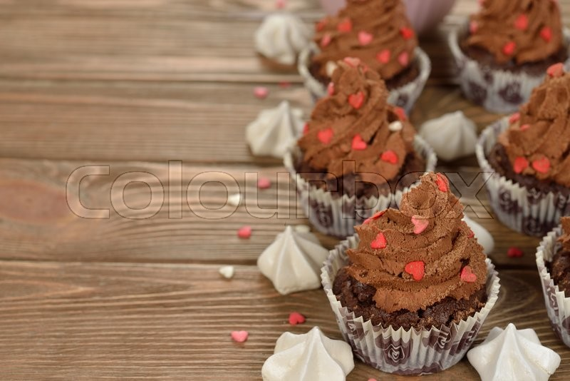 Stock image of 'Chocolate cupcakes on a brown background'