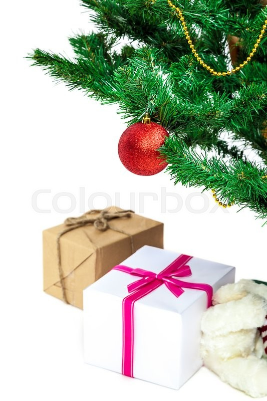Stock image of 'Christmas tree with baubles and gifts isolated on white background.'