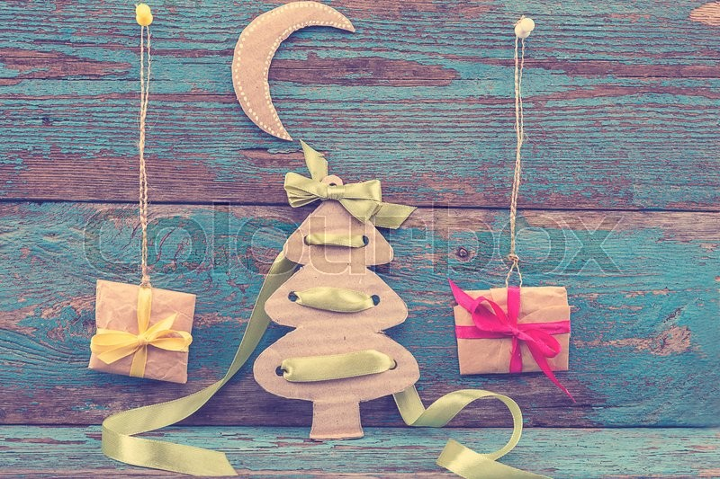 Stock image of 'Christmas decorations with fir tree, balls and gifts on wooden boards painted in blue.'
