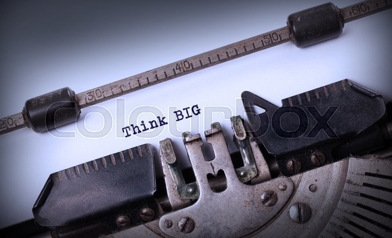 Stock image of 'Vintage typewriter close-up - Think BIG, concept of progress'