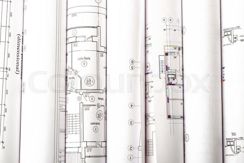 Stock image of 'Architectural blueprint rolls on white, close up view'