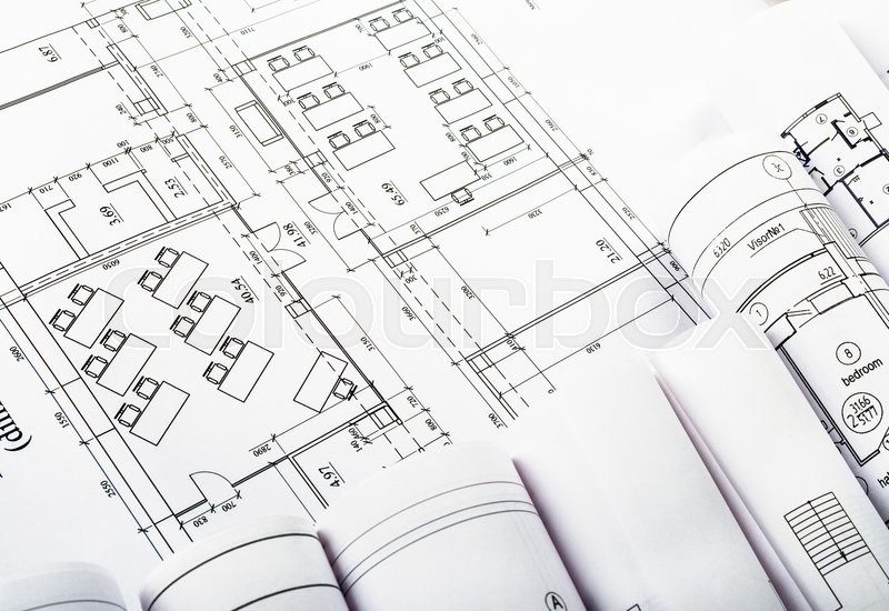 Stock image of 'Architectural blueprint and set of blueprint rolls'