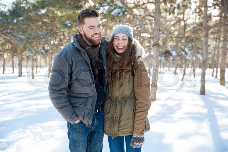 Stock image of 'Laughing young couple standing in winter park'