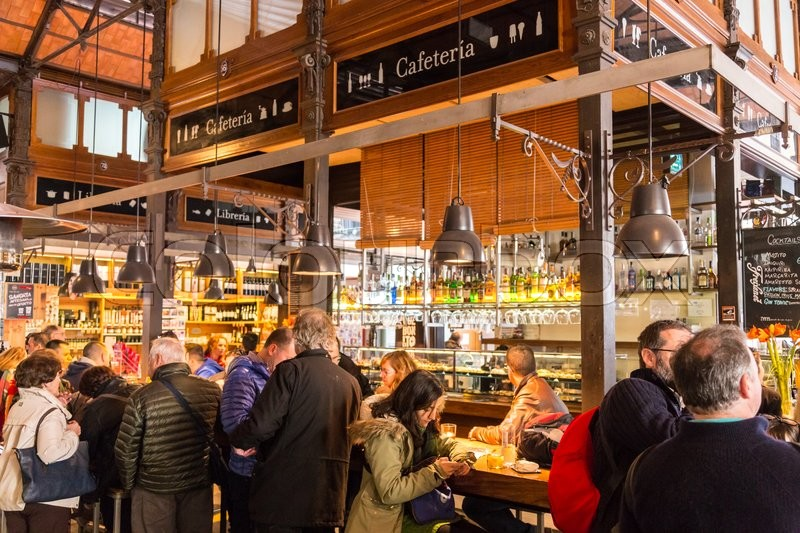Editorial image of 'Madrid, Spain - Jan 25, 2016:  People eat and drink at Mercado San Miguel on January 25th, 2016 in Madrid, Spain. According to Tripadvisor it is one of top tourist sites in Madrid.'
