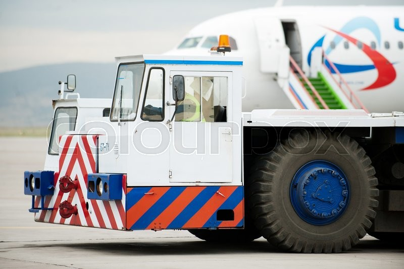 Stock image of 'Tug pushback tractor in the airport in Russia.'