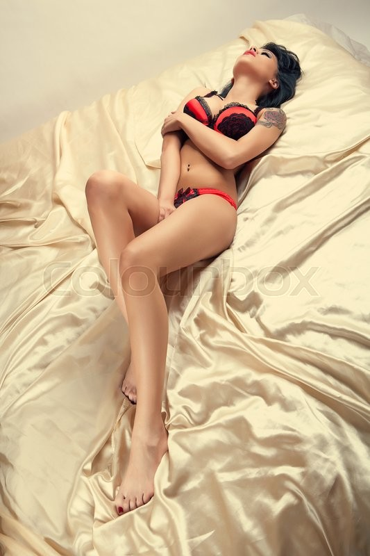 Stock image of 'attractive laying sexy girl with red and black lingerie'