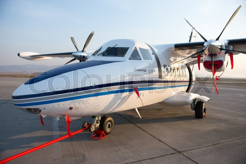 Stock image of 'Ulan-Ude, Russia - April 22, 2014: New white Let 410 airplane parked at the airport Baikal.'
