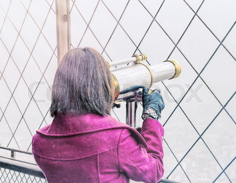 Stock image of 'Vintage back view of a woman looking in city telescope.'