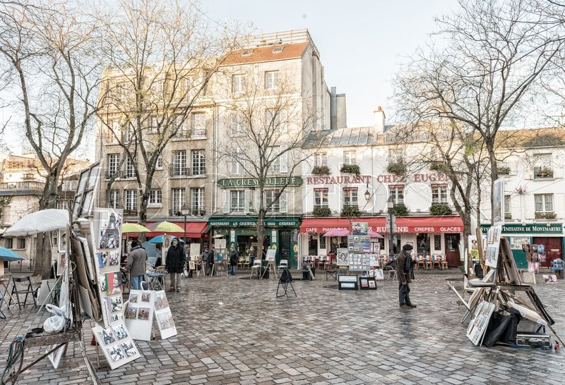 Editorial image of 'PARIS - NOVEMBER 23, 2012: Artwork set up in Place du Tertre in Montmartre. Montmartre attracted many famous modern artists including Picasso and Dali.'