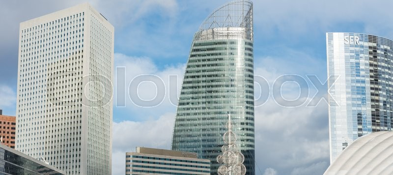 Stock image of 'PARIS - NOVEMBER 22, 2012: Tall buildings in the major business district, La Defense, in the western side of Paris, France. Here are many of the Paris urban area's tallest high-rises.'